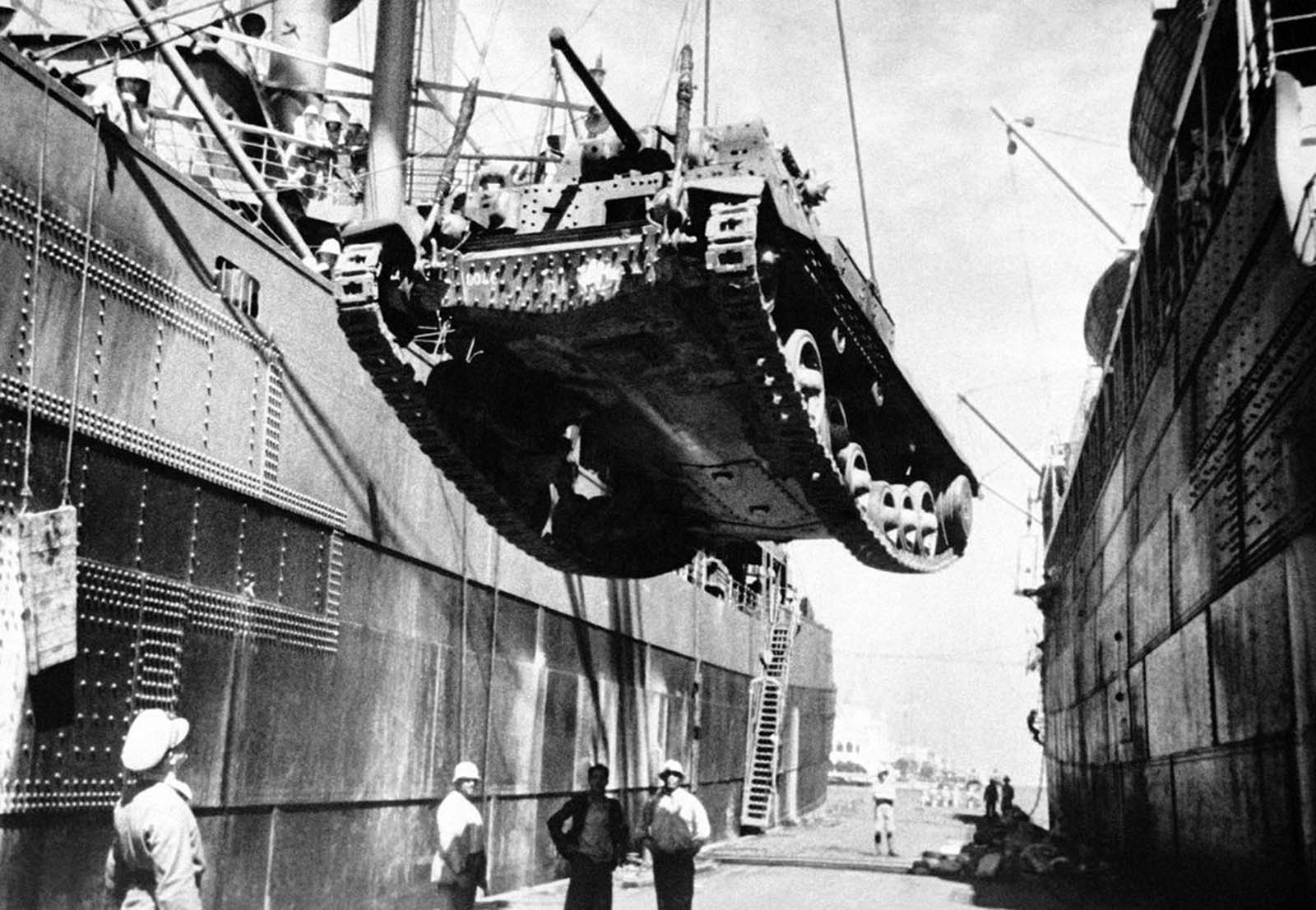A British Cruiser tank is unloaded at a port in Egypt, on November 17, 1940. It is one of a large number which had just been shipped there by British forces.