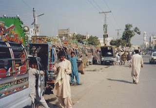 A road with elaborately decorated rickshaws in Islamabad, Pakistan (on the way to Peshawar)