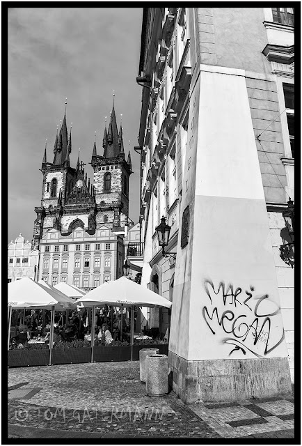 The Steeples Of The Church of Our Lady Before Týn Stand Above Old Town Square in Prague