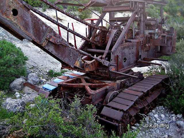 After a mining road was washed away this P&H Model 206 power shovel was abandoned.