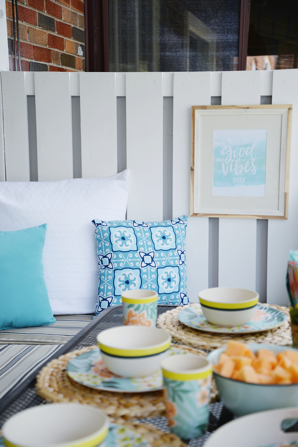 Rambling Renovators | tropical decor, outdoor pillows, blue white rattan decor, good vibes only print