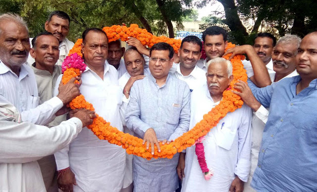 rajesh-nagar-bjp-leader-tigaon-being-welcome-bhuapur-village