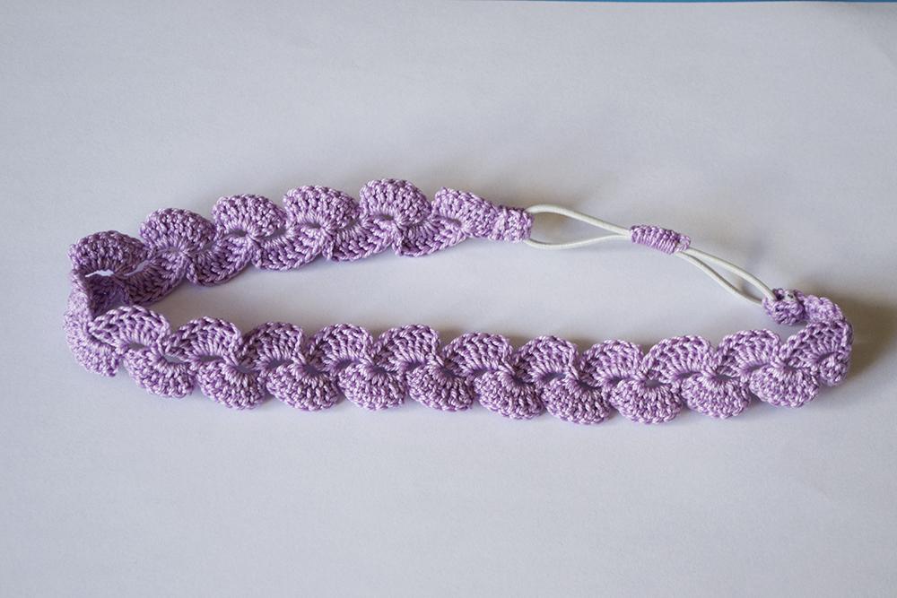 La aguja del sur diadema lila con flor de ganchillo for Diademas para bebes de ganchillo