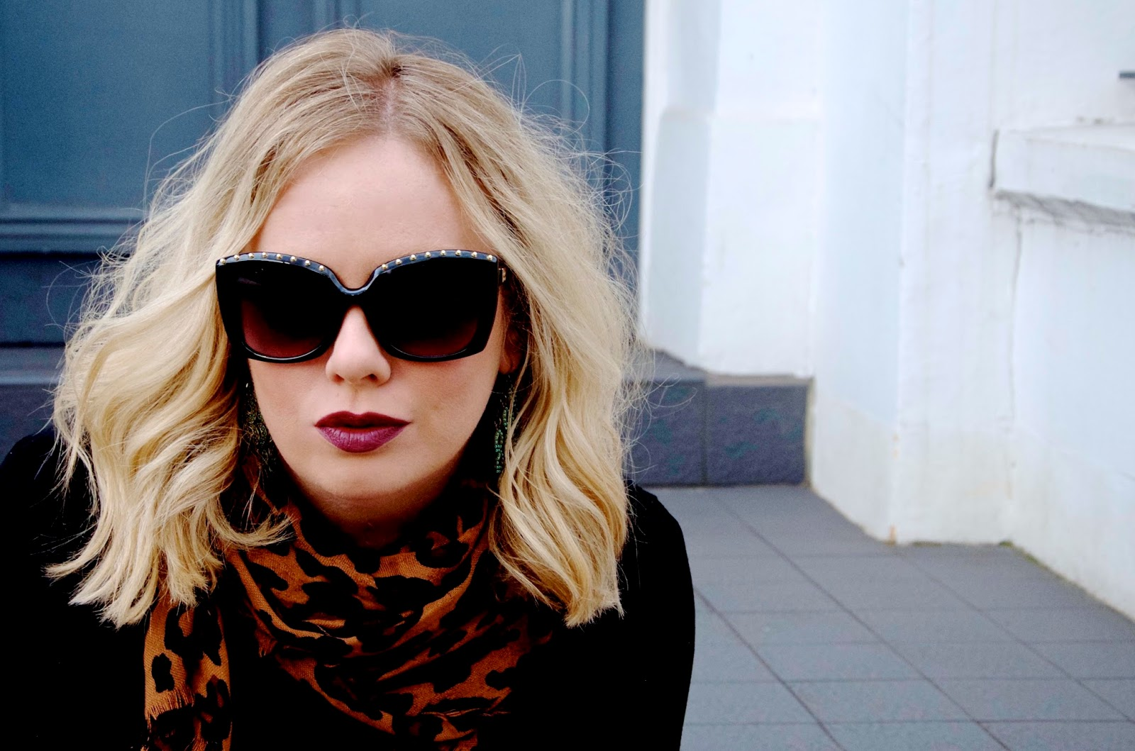 Leopard scarf, purple lipstick and studded sunglasses
