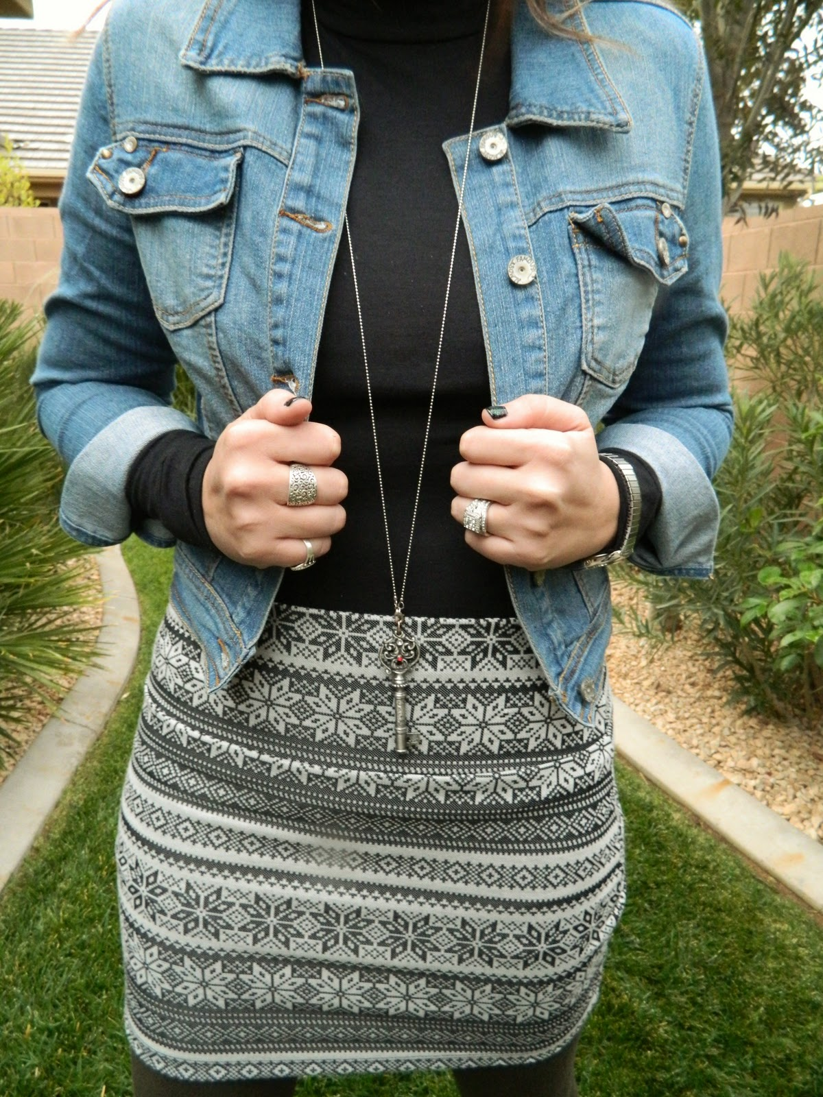 jean jacket, key necklace, black top, grey skirt