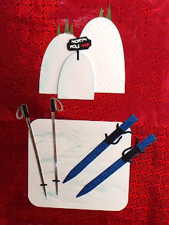 ski hills, skis with poles, gift bag