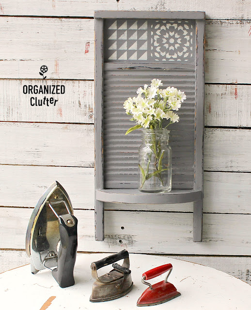 Photo of painted, stenciled washboard with shelf staged