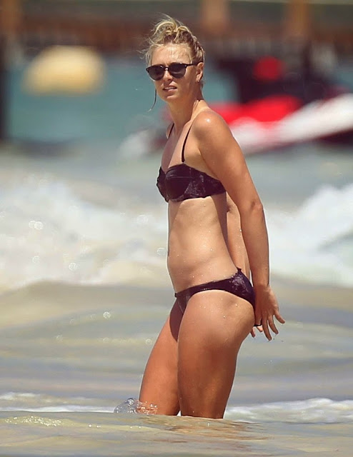 Maria Sharapova in a black bikini on the beaches of Cancun