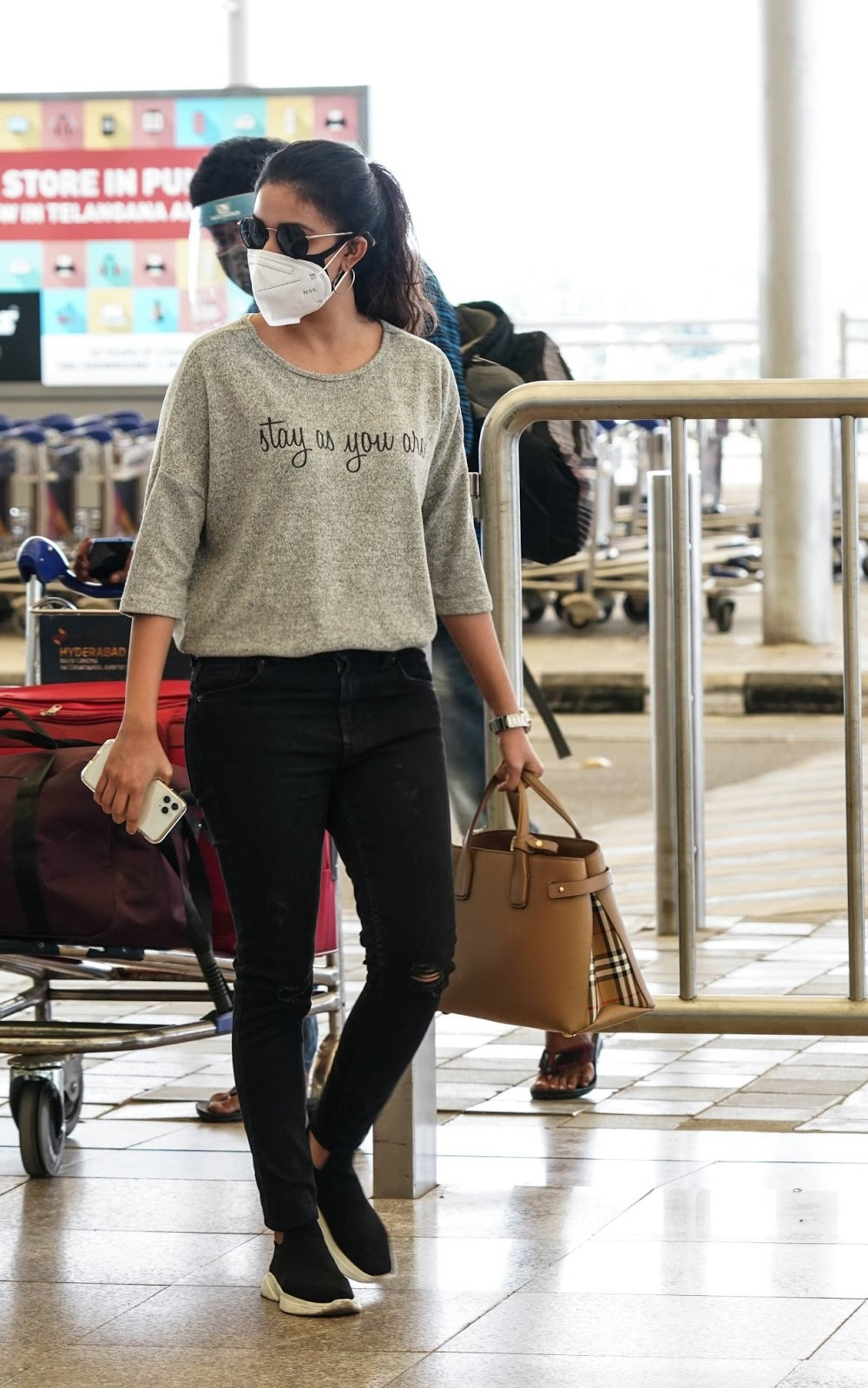 Keerthy Suresh in the Mask with Stunning Walk Style at Hyderabad Airport 1