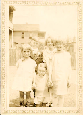 Unidentified boy, possible First Holy Communion celebration, with four other children. c. 1920's?