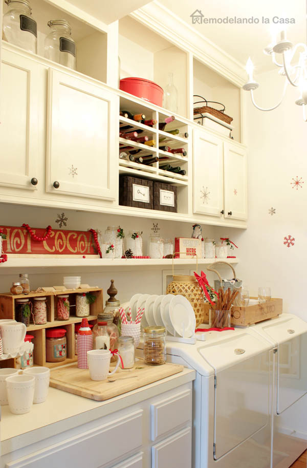 Red and white Christmas decor for Cocoa station with lots of goodies