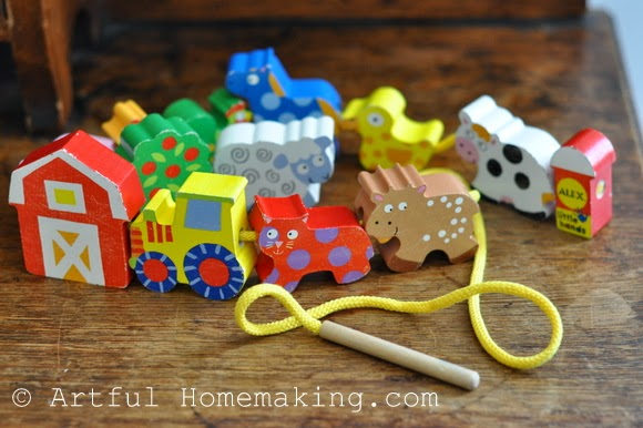 Fine Motor Coordination: Keeping Little Ones Hands Busy. Wooden farm animals called String-a-farm