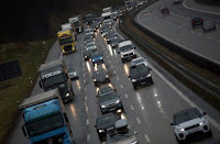 Cars and trucks are stuck in a traffic jam near Irschenberg, Germany, March 29, 2018. (Credit: Reuters/Michael Dalder/File Photo) Click to Enlarge.