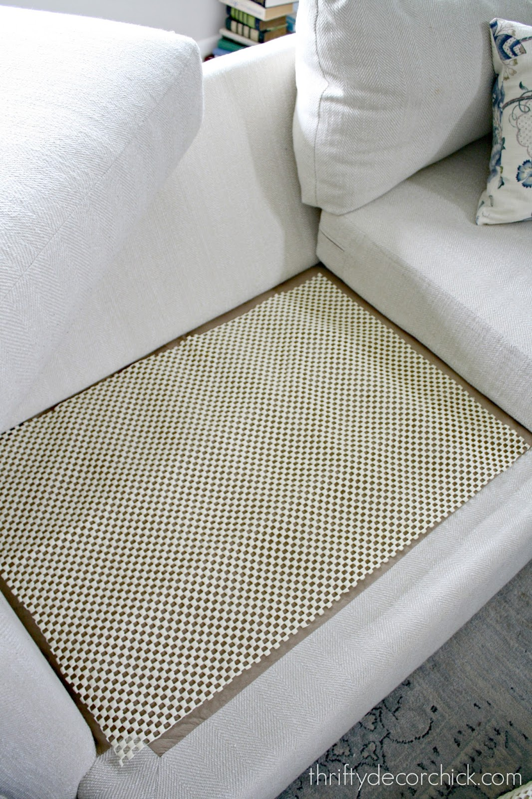Easy trick to keep sofa cushions from sliding