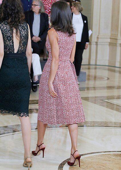 Queen Letizia wore a v-neck zig-zag print midi dress by Carolina Herrera and Lodi burgundy suede ankle strap pumps