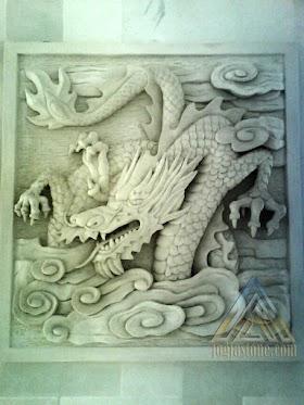relief motif naga batu alam paras jogja