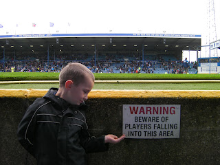 funny sign at football club ground