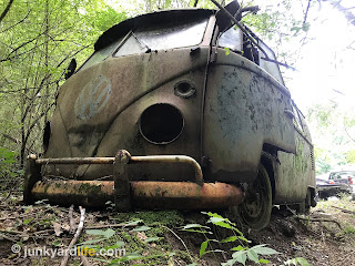 Ground eroded by water on driver's side of 1965 VW bus.