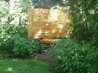 Zen cedar bench and cedar privacy screen in a quiet corner by garden muses: a Toronto gardening blog
