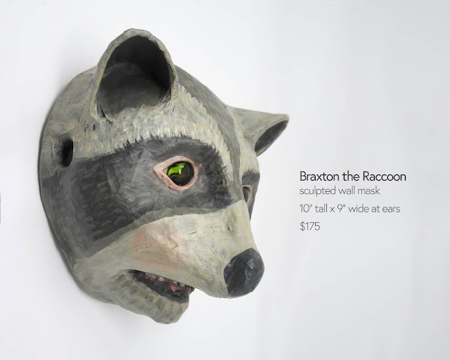 raccoon mask sculpture