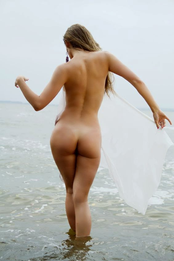 naked lady paddling in sea