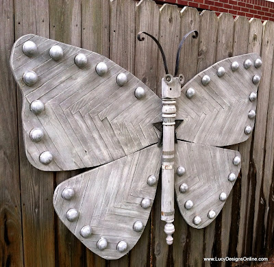 wooden butterfly five feet wide recycled art