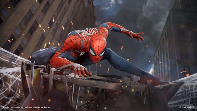 The character Spider Man squats on a webbed crane between two tall buildings, from Spider Man