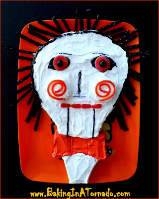 Blog With Friends: Scary Stuff for October | Billy the Puppet Cake: This character from Saw makes the perfect Halloween party cake | Recipe developed by www.BakingInATornado.com | #recipe #dessert #Halloween