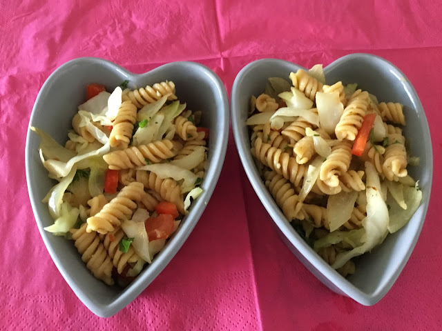 two heart shaped bowls with pasta