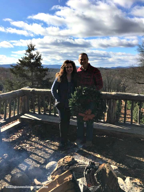 My hubby and I by the bonfire after cutting down our Christmas tree from Walking on Sunshine.