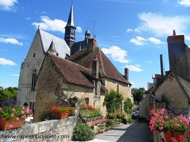Picturesque street in Montresor with church in background