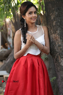 Actress Mahima Nambiar Latest Stills in White Top and Red Skirt at Kuttram 23 Movie Press Meet  0015.jpg