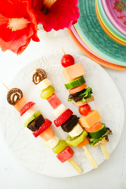 Sandwich and fruit skewers on wooden skewers