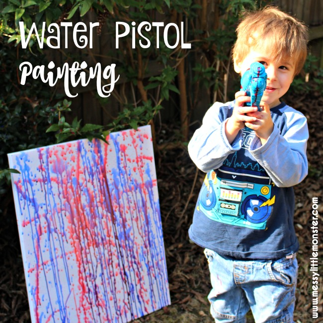 Water gun painting.  Outdoor summer art activity for kids