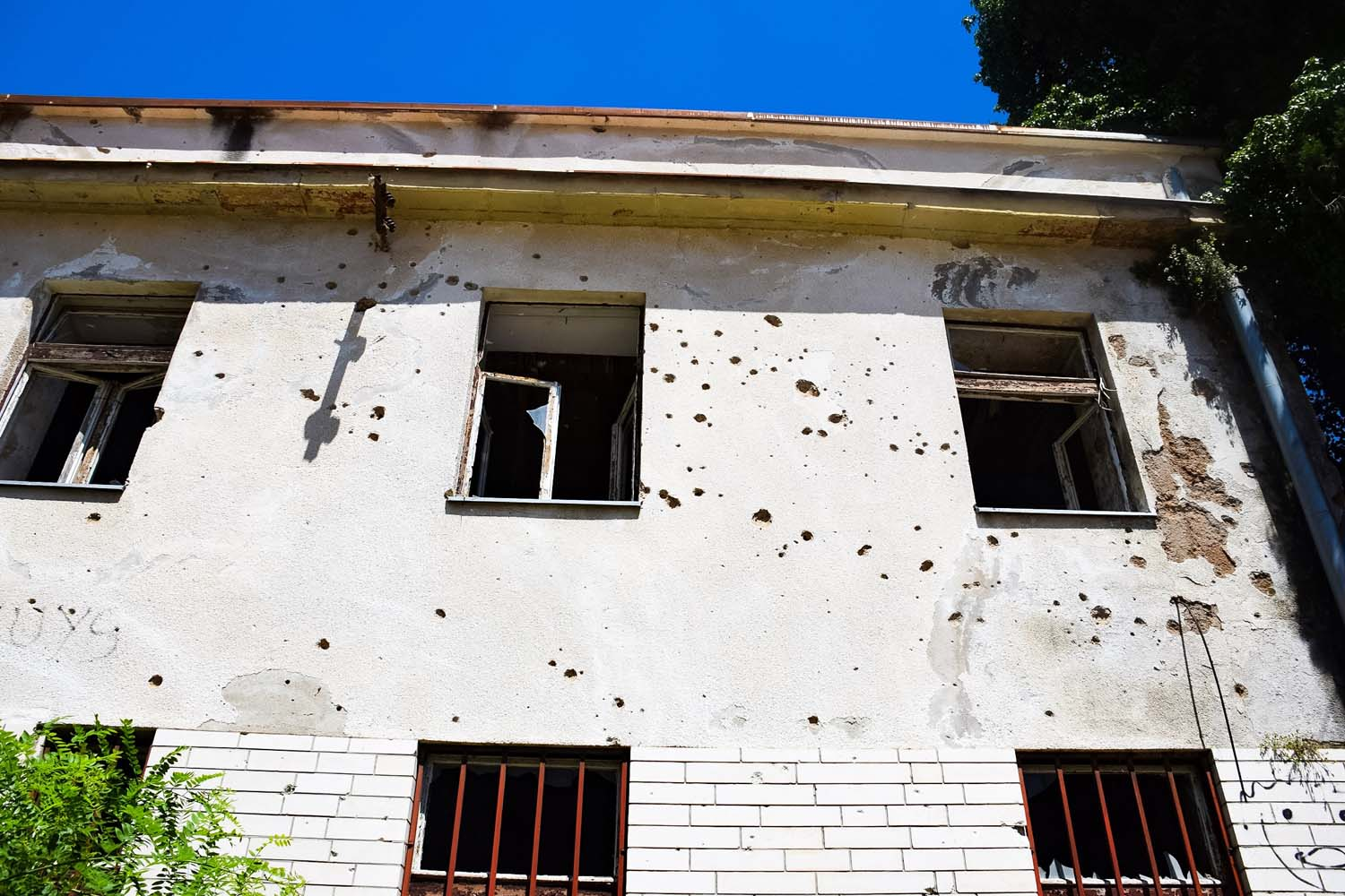 bullet holes in buildings around mostar