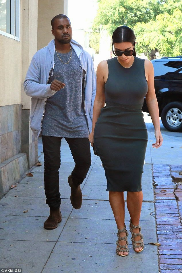 1413079012972 wps 70 Los Angeles CA It looks l Kanye cant stop smiling on stroll with Kim hours after explaining why he doesnt smile