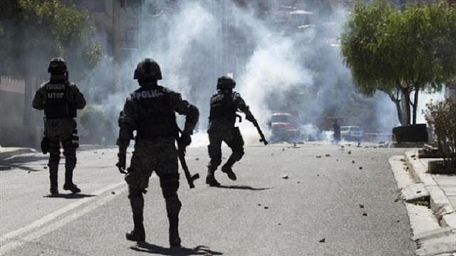 Clashes erupt between Bolivian police and a group of miners