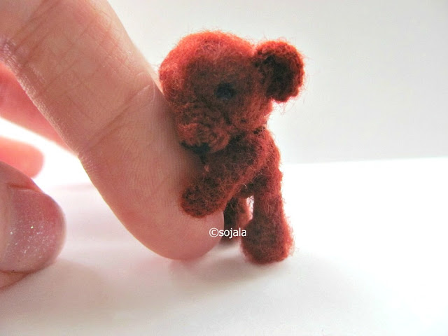 miniature brown teddy bear made with embroidery thread