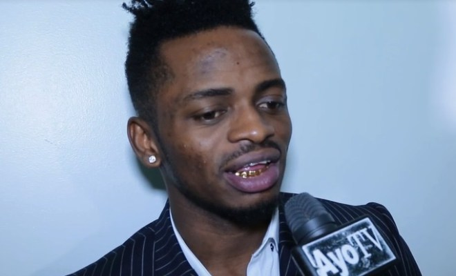 Exclusive video diamond platnumz shows off his gold teeth while he