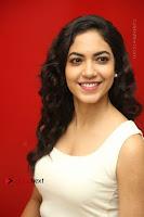 Actress Ritu Varma Stills in White Floral Short Dress at Kesava Movie Success Meet .COM 0188.JPG