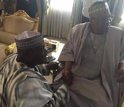 Atiku kneeling before Ibrahim Badamosi Babangida
