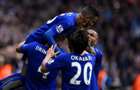 Riyad Mahrez of Leicester City celebrates with his teammates.