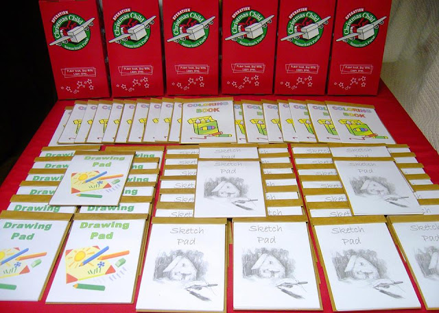Hand made coloring books and sketch pads for OCC shoeboxes.