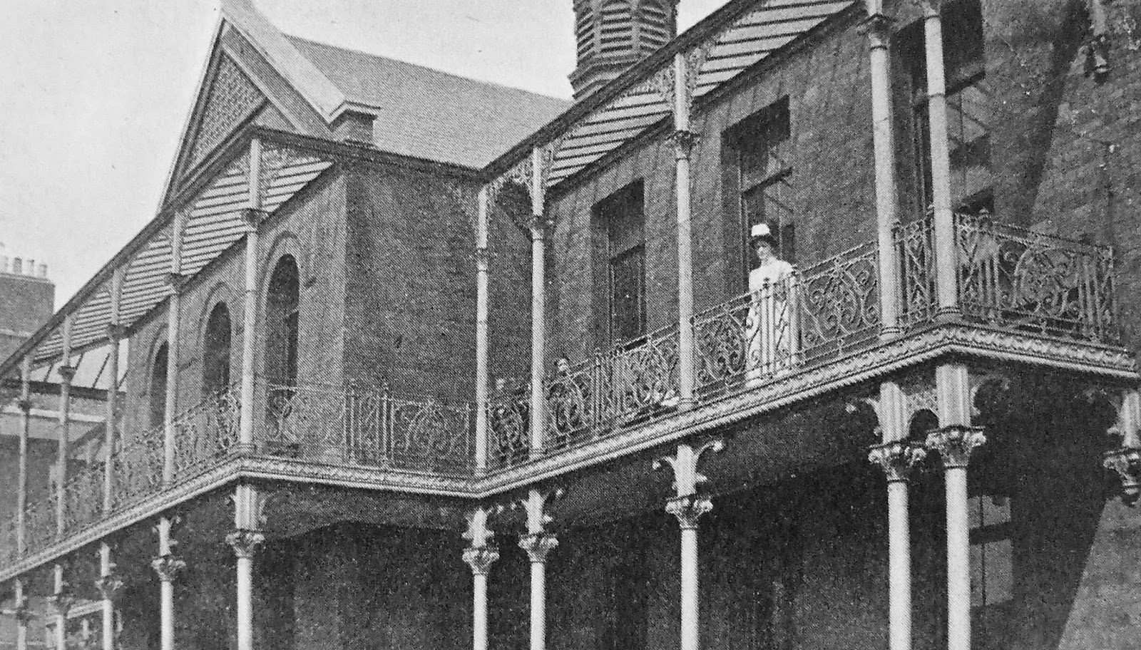 Nurse and two children on the balcony of the Red House, Cork Street Fever Hospital, Dublin, Ireland, 1909