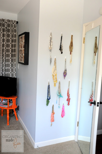 Jewelry organized behind the door with hooks