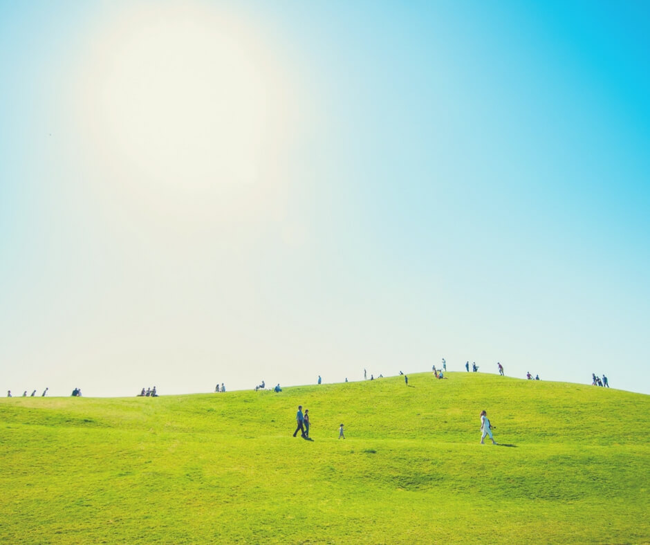 People walking on a grassy hill in the bright sunshine. Image for Post Comment Love 20th - 22nd April.