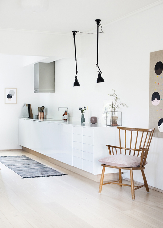 Swing arm lamps in the kitchen | Katrine Rohrberg via Mad & Bolig