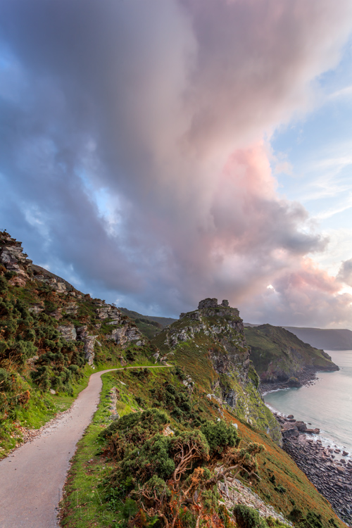 Exmoor National Park coastline at the Valley of Rocks with huge clouds at sunset