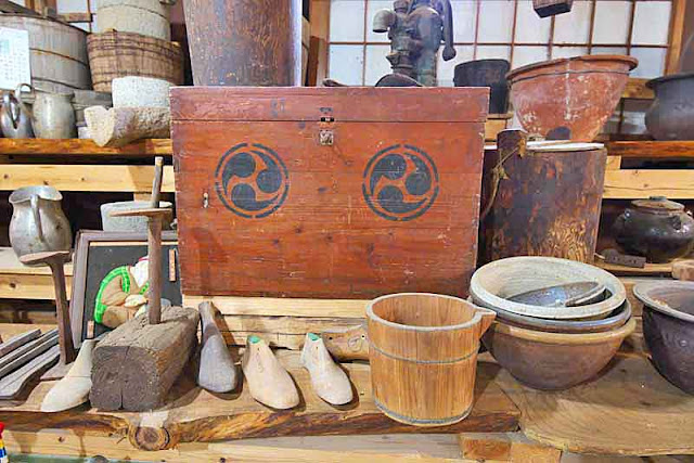 pots, pans, buckets, shoemaker materials, wooden box