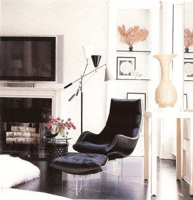 modern living room in black and white furniture, lucite chairs and fireplace via belle vivir blog